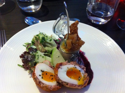 Scotch egg and potted pork belly with pork scratching and apple chutney