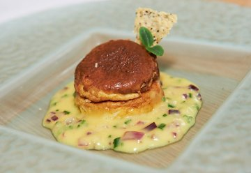 green olive soufflés, served with black pepper and parmesan, accompanied by a chive and red onion hollandaise sauce